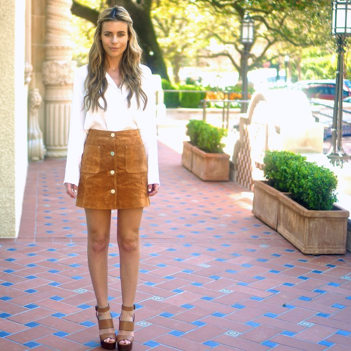 The Pearl Oyster is wearing a suede Asos button downed mini skirt