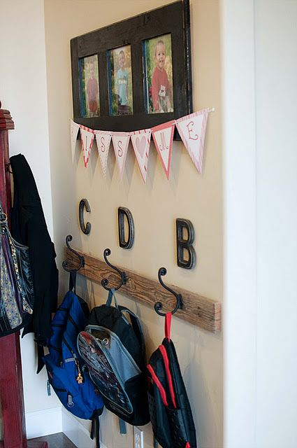Love this mud room organization. Picture & Initial over hooks for the kiddos' coats and backpacks