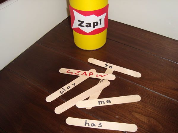Zap! Pull out a word and identify, pass can, when child picks zap! they put all their sticks back.