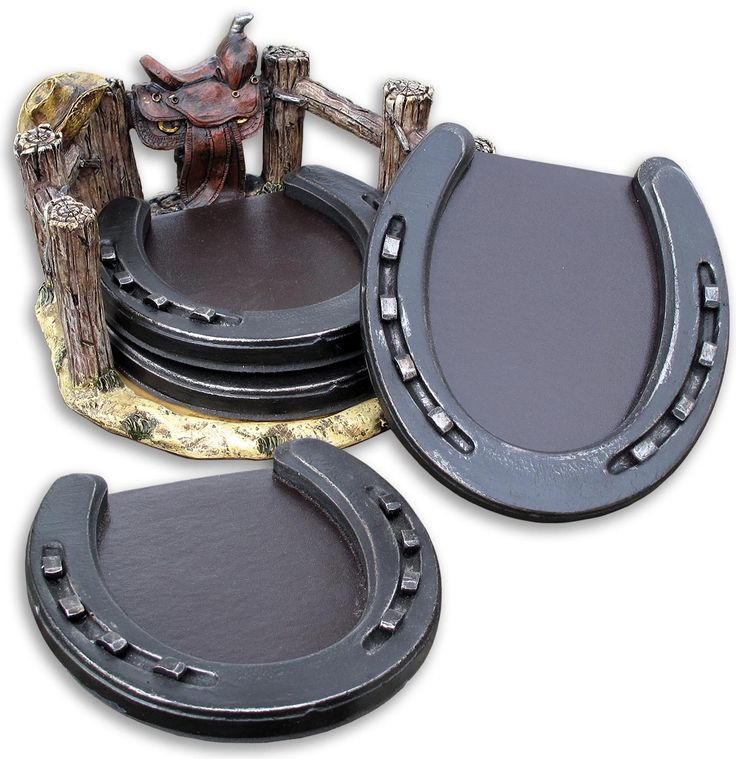 "This set of four horseshoe coasters have a non-skid leather-look neoprene ""pad"" inside each one to protect your furniture against sweating glasses.  The ""corral"" they come with is just that - a wood-look resin corral with a western saddle and cowboy hat thrown in for good measure. The coasters measure 4 1/2"" wide x 5"" long."