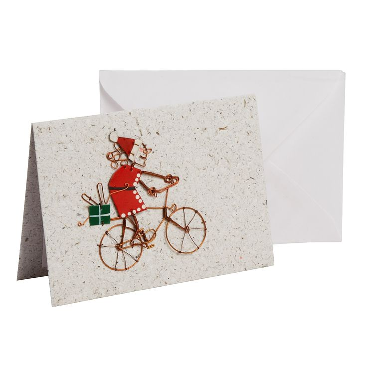 It's a little-known fact that Mrs. Claus helps to deliver all of Santa's forgotten presents via bicycle! This fun card from the artisans of KICK Trading is a festive greeting for the holidays.