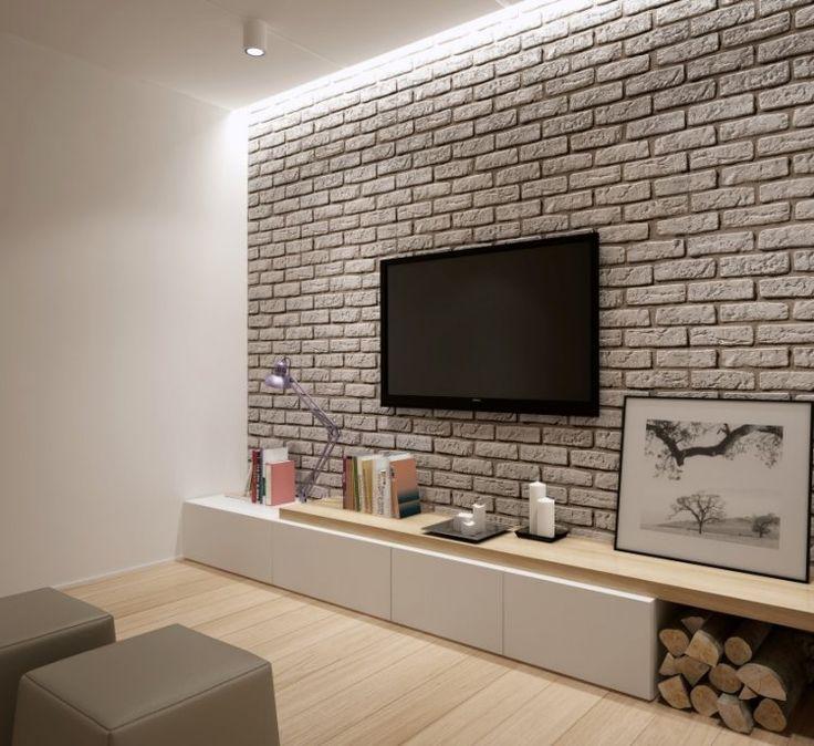 Kamień dekoracyjny imitujący cegłę ułożony na ścianie z telewizorem nadaje wnętrzu charakter industrialny. Fot.: Stone Master