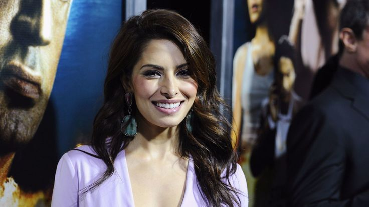 """Actress Sarah Shahi attends the 2013 """"Bullet To The Head"""" premiere in New York."""