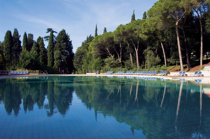 The bay and beach are accessible through abundant greenery, a luscious lawn and beautiful outdoor swimming pools.  Hotel Eden in Rovinj.  http://www.maistra.com