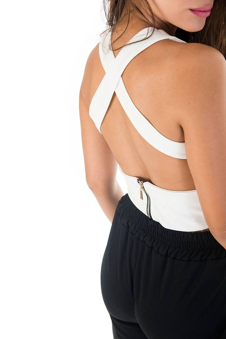 Crossover top with V neckline and deep back opening. Back gold zip fastening. 95% Polyester. 5% Elastane. https://www.modaboom.com/stauroto-top.html