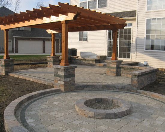 Great option to include a fire pit. Would prefer the pergola to be white and attached to the house.