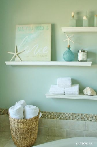 click here to make floating shelves in sea green bathroom