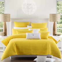 The elegant simplicity of Taya comes to life with the clear brilliance of yellow, a colour that is both fresh and vivid, with a radiance that lifts and highlights the luxurious look of the ribbed and quilted fabric.  A dramatic centrepiece for the bedroom, Taya Yellow will command immediate attention with its striking colour and presence.