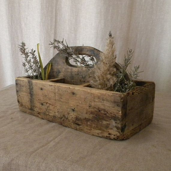 This vintage wood tool caddy will add a touch of French country to your home. Found in a French flea market, it has X marked on one of the short sides
