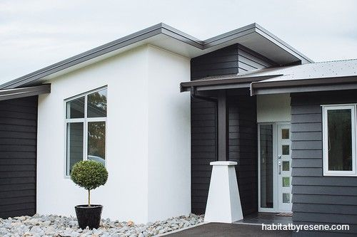 A crisp black and white colour combo enhances the shapes of this contemporary home.