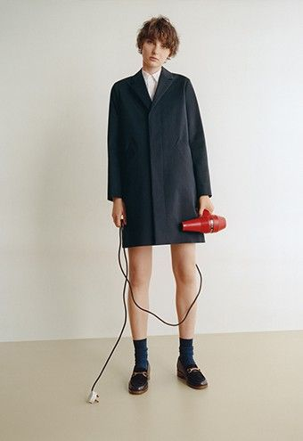 Look 20 Silvana coat in supple dark navy blue gabardine. Dana short-sleeve shirt in white striped end-on-end cotton. Denim stud ring in silver. Diana moccasins in smooth dark navy blue leather and nubuck leather.