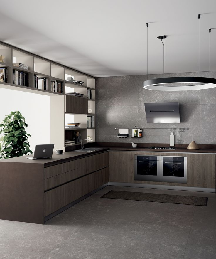 Solution without wall units to make the most of the storage capacity of the quality base units and baskets, with 22 mm thick doors made of Along Oak decorative melamine for both kitchen and living room trendy compositions.