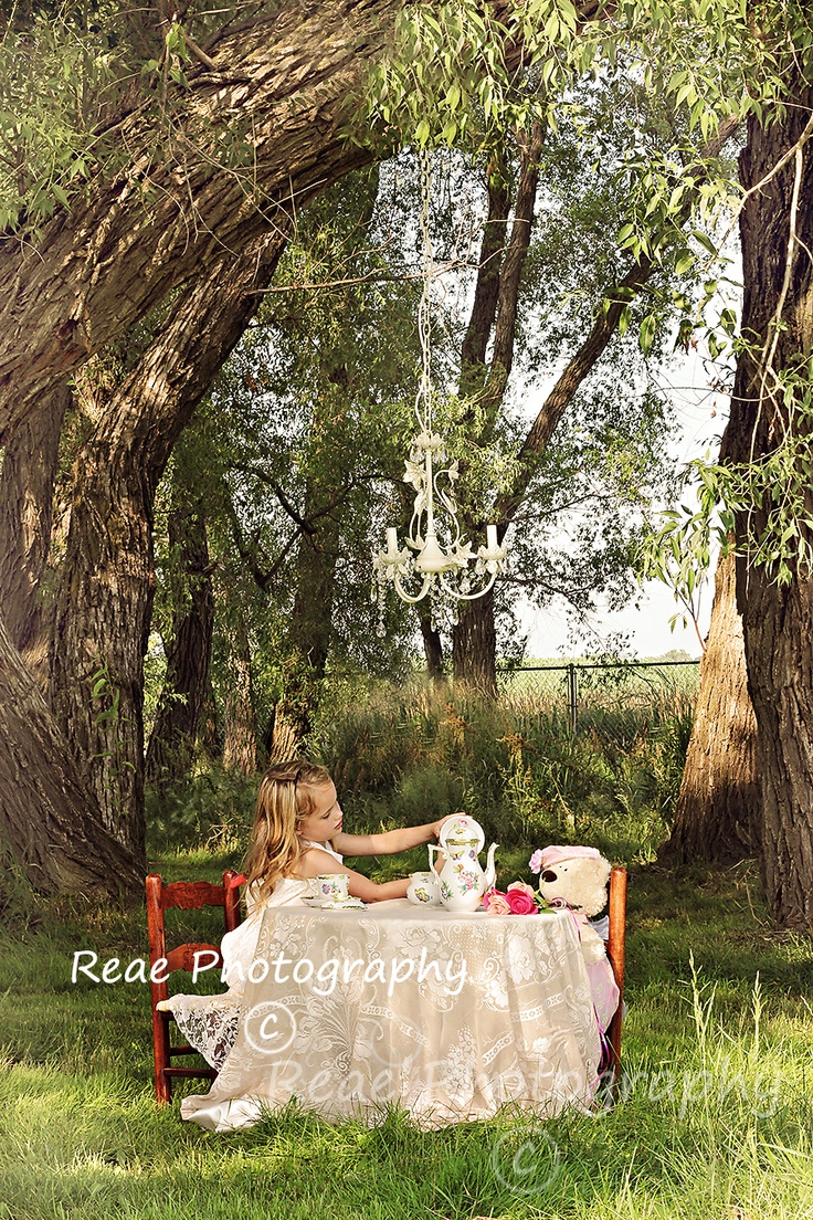 Love the chandelier hanging from the tree... Perfect touch for a tea party photo shoot...