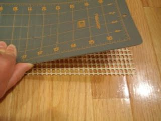 Use a piece of carpet grip material cut to the size of your rotary cutting mat so it won't slide around on your cutting table.