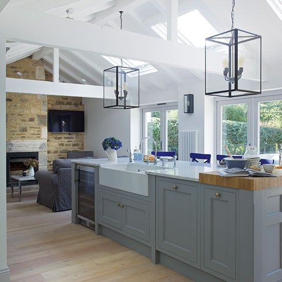 Grey open-plan Shaker-style kitchen. The blue chairs-- what a perfect touch