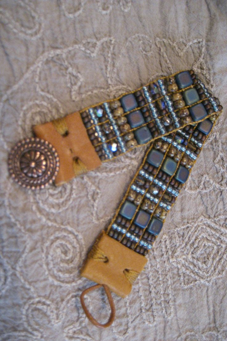 Denim Blues, Picasso Browns, Rusty Earthy Browns Hand Loomed Beaded Bracelet, Leather End Tabs and Copper Button Closure by FlyByNightBracelets on Etsy https://www.etsy.com/listing/220284912/denim-blues-picasso-browns-rusty-earthy