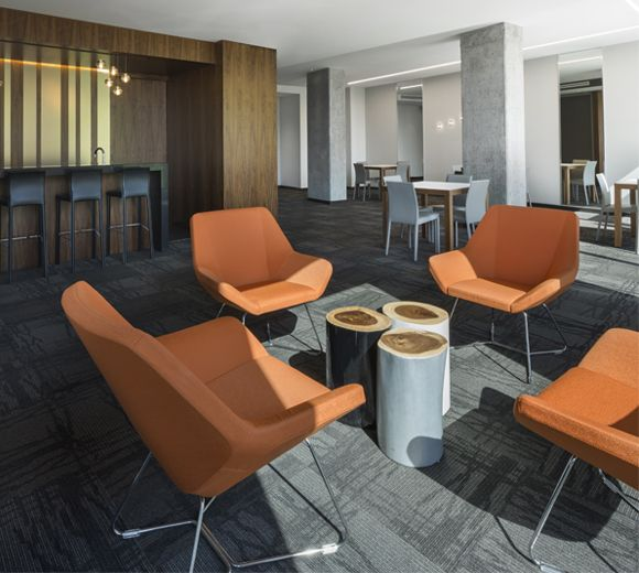 POINTE-NORD | Montreal | Architecture | Interior Design | Evolo 2 | Residential | Wood | Chair | Table | Lobby | Orange | Gold | Art | Light | Carpet | Artwork | Fabric