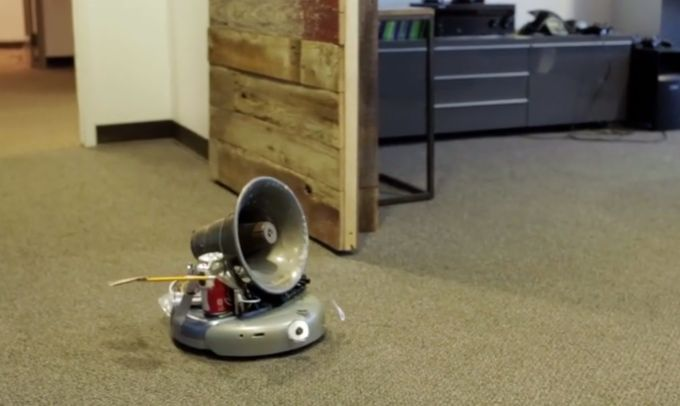 Slackbot Bot is a wonderfully wonky little robot hobbled together out of an older Roomba, a Raspberry Pi, and a Tornado Siren