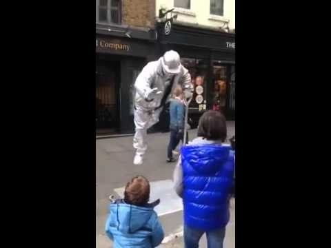 A mute comediant seems to be  on levitation. How is this guy standing. T...