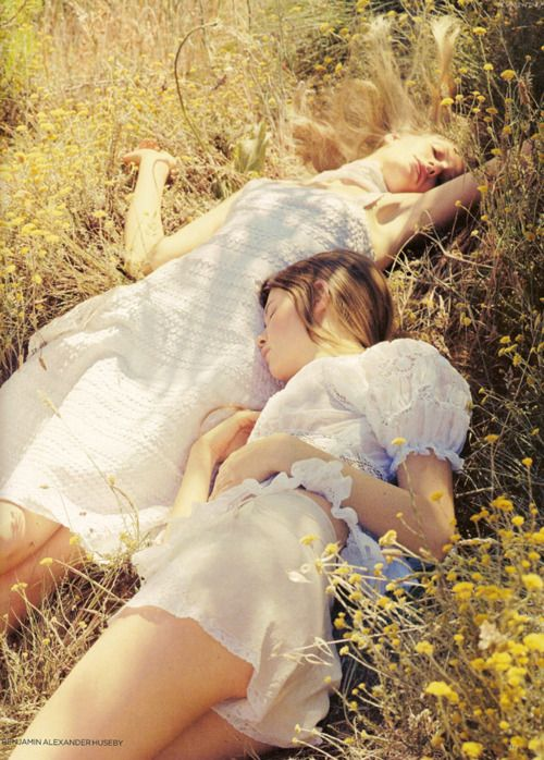 Two young milk maidens fast asleep in the meadow, dreaming of their suitors to be.