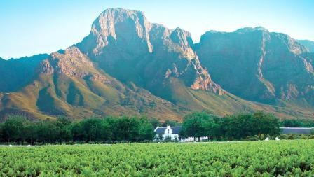 The largest wine producing region in the Western Cape, the winelands with it's many historic wine estates, characterised by classic Cape Dutch-style buildings and massive vineyards date back centuries and are bordered by the Hottentots Holland, the Franschhoek mountains and in the North by the Wemmershoekberg.
