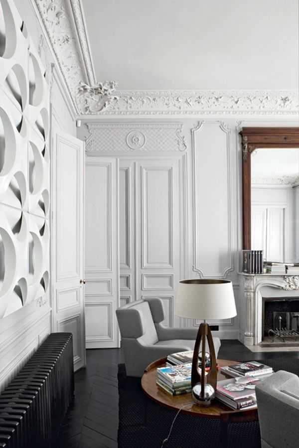 A 19th C. Paris Apartment with great molding, gets a new update and mix of modern.