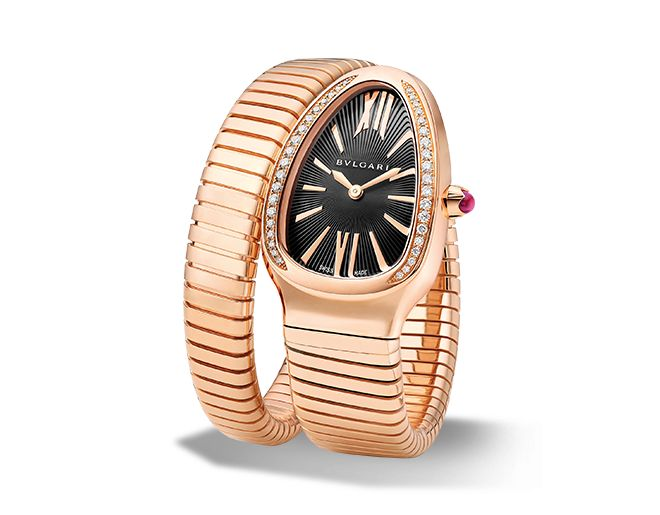 Quartz movement. 35 mm 18-ct pink gold curved case set with brilliant-cut diamonds. 18-ct pink gold crown set with a cabochon-cut pink rubellite. Black opaline dial with guilloch