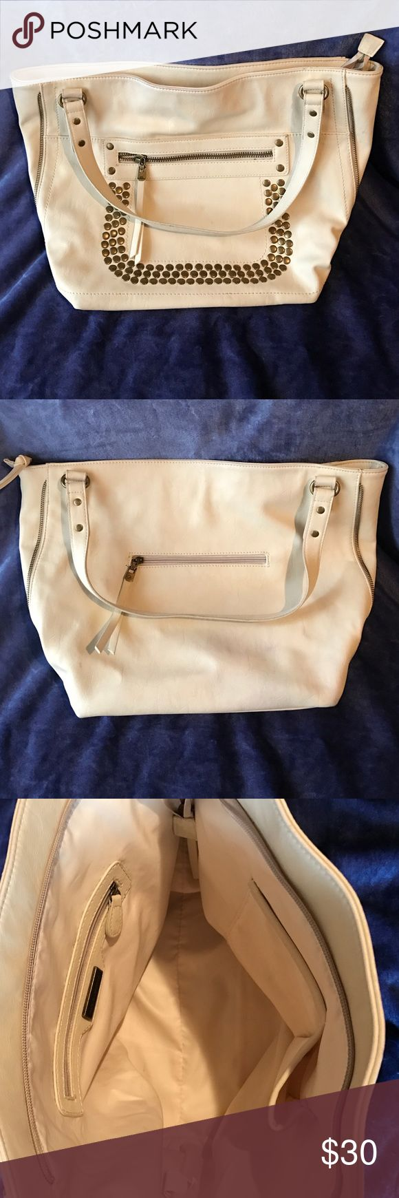 Big Buddha Handbag Cream Color Big Buddha Handbag cream in color. In good used condition slight discoloration on back of Handbag shown in picture. Handles in good shape. Zippers work great! Open to reasonable offers any questions feel free to ask! Thank you for looking! Big Buddha Bags Shoulder Bags