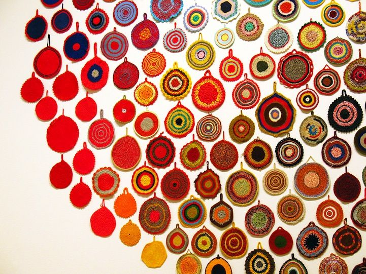 This colorful installation is a collection of crocheted potholders by artist Anu Tuominen. In much of her work, the Finland-based artist redefines the function of basic, everyday stuff. She finds neglected and unloved goods, and by reworking these things, she gives them new life as conceptual art