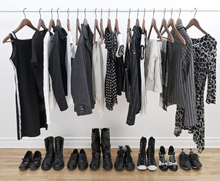 Female clothes on hangers and shoes