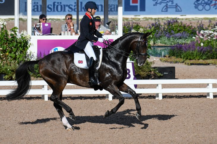 Britain's Spencer Wilton leads grand prix special at halfway stage http://trib.al/UaQGX6D