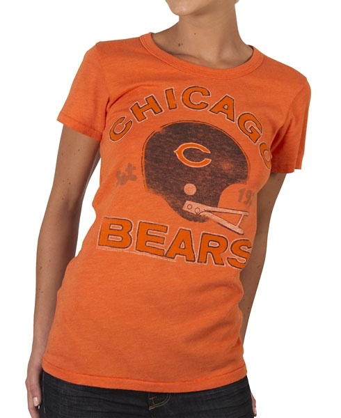 This officially licensed Women's NFL shirt by Junk Food features a vintage print of the Chicago Bears team helmet along with the year the team was established.    Fabric Details  Color: Orange  50% cotton / 50% polyester  Our Price: $24.95