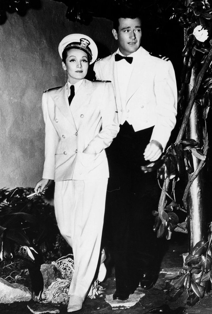"Marlene Dietrich and John Wayne on the set of ""Seven Sinners,"" 1940."