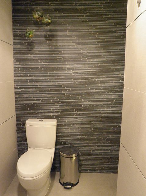 Like the wall tile in this Eichler master bathroom remodel