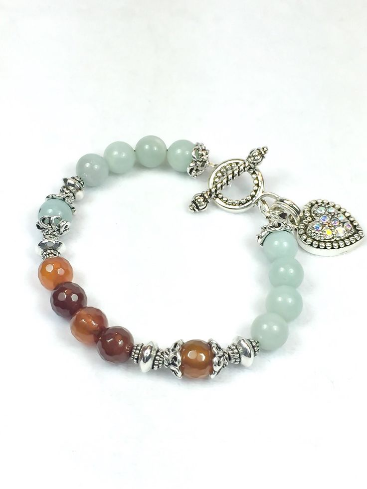 This original elegant bracelet is hand-crafted with Brown Agate combined with a light blue stone, silver caps, silver beads and a beautiful Swarovski Clasp. This is a great bracelet to wear anytime. Y