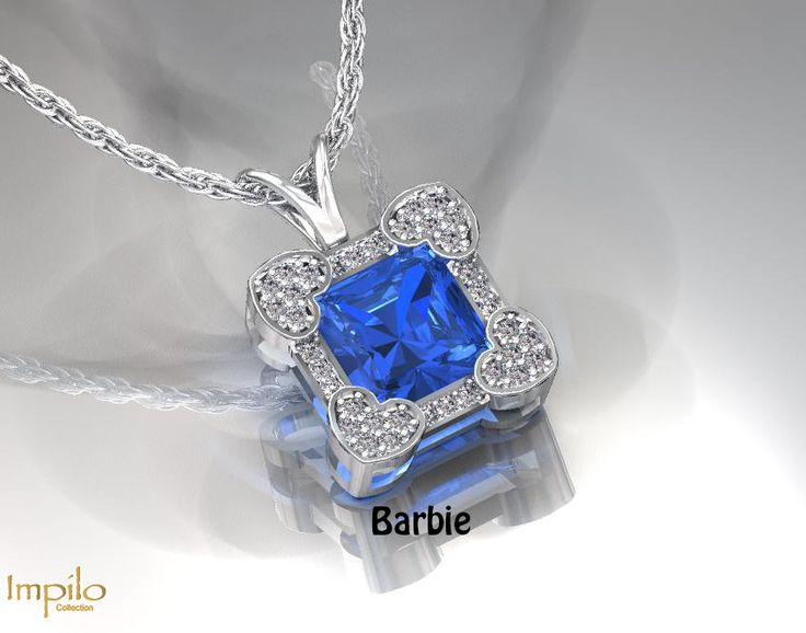 """""""Barbie"""" - Elegant heart design with a beautiful blue topaz centre stone and round brilliant cut diamonds on each corner, surrounded by smaller diamonds and finished off with a rabbit ear bail."""