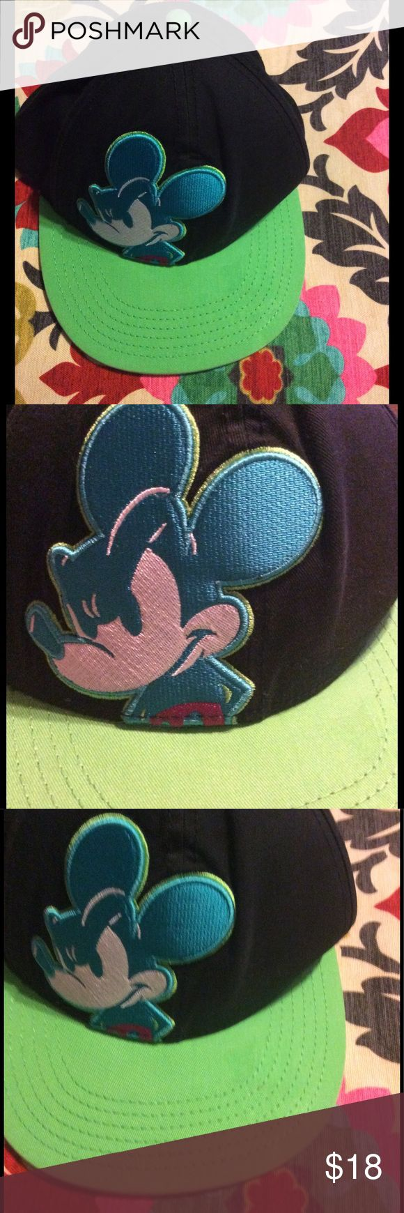 Disney SnapBack flat bill hat neon Mickey Disney SnapBack neon Mickey flat bill hat. New without tags. There is a tiny bit of sticker residue as shown in close up picture. You can barely see it. Bill is flat has not been shaped or bent. Colors are neon green and blue on a black background. Disney Accessories Hats