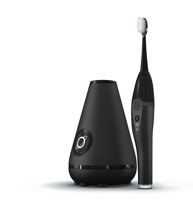 Aura Clean System - It's an ultrasonic toothbrush with a charging dock that doubles as cleaning station. When you're done brushing with the dual-mode brush, stick it headfirst into the dock, where germ killing technology cleans & dries the brush while it charges. | werd.com