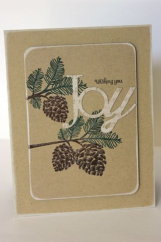 handmade Christmas card ... kraft ... pine cone branch ink with brown and green ... die cut JOY stamped in white ... like the white frosty look of the sponged edges ... Paper Trey Ink