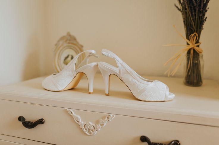 Pretty lace peep-toe bridal shoes. Photo by Benjamin Stuart Photography #weddingphotography #bridalshoes #laceshoes #weddingday #bride #whiteshoes