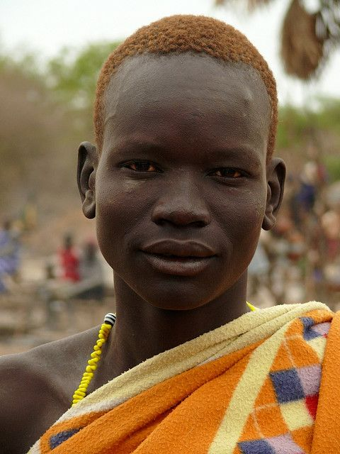This young Dinka man had dyed his hair, and it matched the cloth he was wearing beautifully. 2008 0227 Dinka cattle camp by ngari.norway, via Flickr: