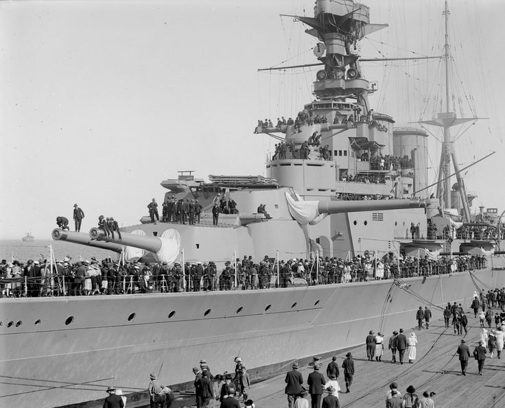 HMS Hood in New Zealand in 1924, at the time the largest warship afloat. Here we can see her forward 15 inch naval guns, and her armoured front conning tower.