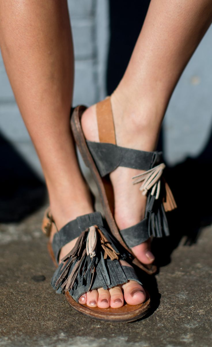 A little bit of fringe never hurt anyone. Add some cool girl flair to your plain jane sandal. Details: - Adjustable strap w/buckle closure - Leather upper, lining, & sole