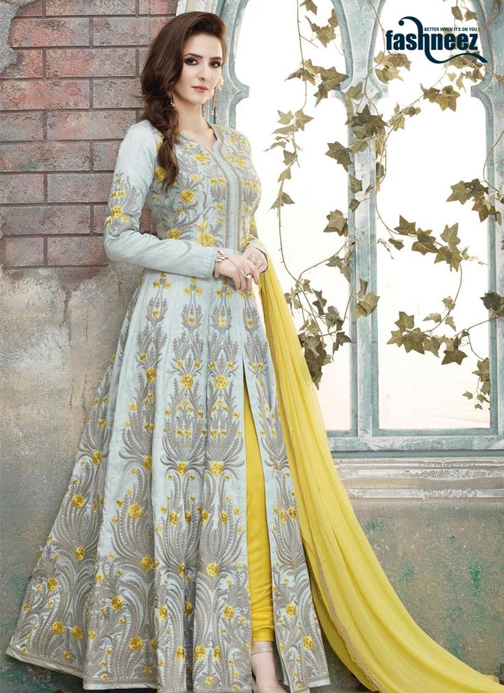 Be the dazzling diva clad in such a grey and yellow art silk floor length anarkali suit with exquisite forms and patterns. The charming embroidered, lace and resham work a significant attribute of thi...