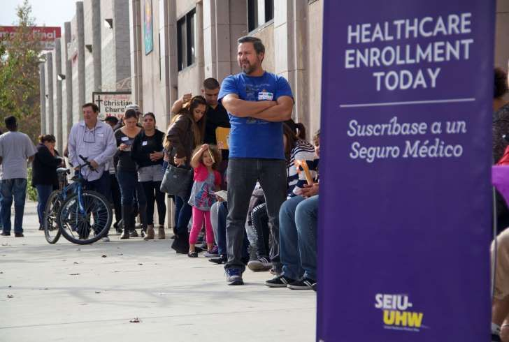 This photo provided by the Service Employees International Union shows people waiting to enter an Affordable Care Act enrollment event sponsored by SEIU-United Healthcare Workers West and Community Coalition, in Los Angeles Saturday, Nov. 15, 2014. California's health care exchange is targeting Latinos and others who missed last year's first enrollment season under the Affordable Care Act. While the process left consumers and insurers frustrated at times, the sign-ups in California were…