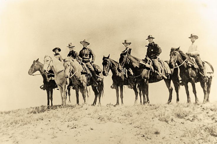 "The badges worn by the Rangers were five-point silver stars with ""Arizona Rangers"" engraved on the front. Officers had their ranks engraved on the front, while privates were assigned numbers. This early 1900s group of Arizona Rangers includes Capt. Thomas H. Rynning, shown third from left. Between 1901 and 1909, when the force disbanded, 107 men served in the Rangers. The average age was 33; the youngest was 22."