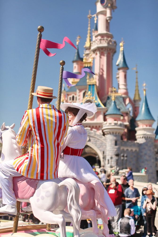 Mary Poppins and Bert in front of the Sleeping Beauty Castle in Disneyland Paris DLP during Swing Into Spring 'Le Château de la Belle au Bois Dormant'