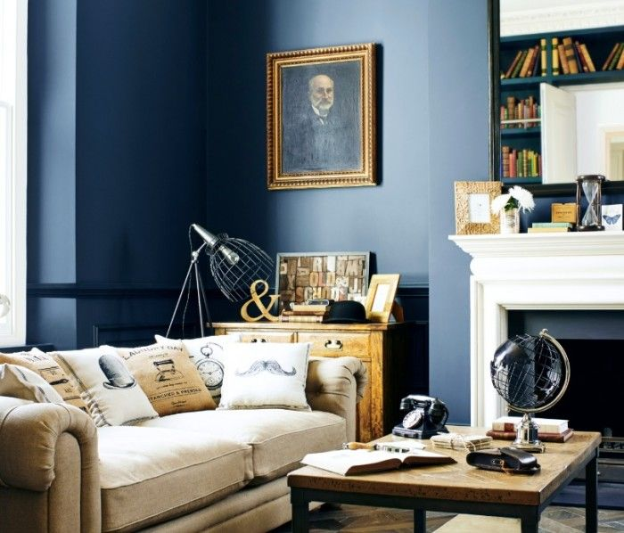 GENTLEMAN'S CLUB. For a truly classy look, choose mellow colour schemes, such as greys and chalky deep blues, mixed with accessories that resemble worldly treasures. Find more interiors trends at housebeautiful.co.uk