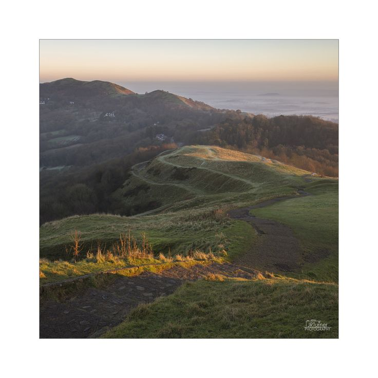 JRTurnerPhotography posted a photo:  A slightly different composition from yesterday. First light on the Malvern Hills on a lovely winters morning. I found it strange how the frost was not on the peaks, but down below it was a thick hoar frost.  Canon EOS 5D Mark III|16-35mm f4 L  I've been teaching Poppy photography, take a look at her Flickr .  Facebook | Twitter | Website