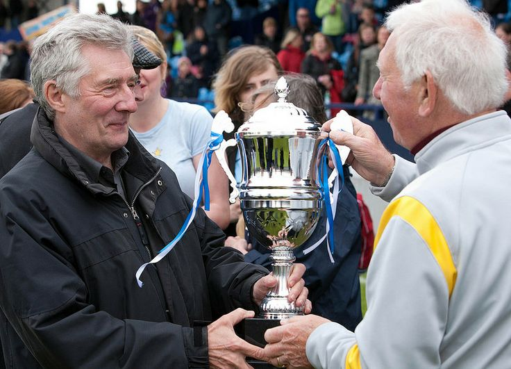 Tony Lloyd, Police & Crime Commissioner for Greater Manchester presents the trophy to City's manager. Manchester City Old Boys took on a Victim Support team – made up of police officers, firefighters, probation workers, New Charter staff and others - on Saturday, 10 May 2014. The game – played at Hyde United's ground raised funds for Victim Support.
